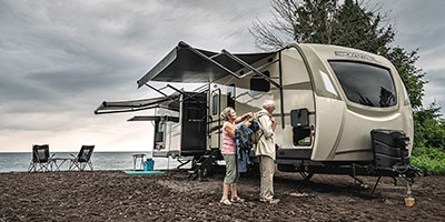 2020 Venture RV SportTrek Touring Edition STT343VIK Travel Trailer Exterior with couple packing for hike